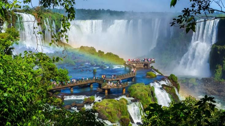 Tourists at Iguazu Falls enjoying the waterfall