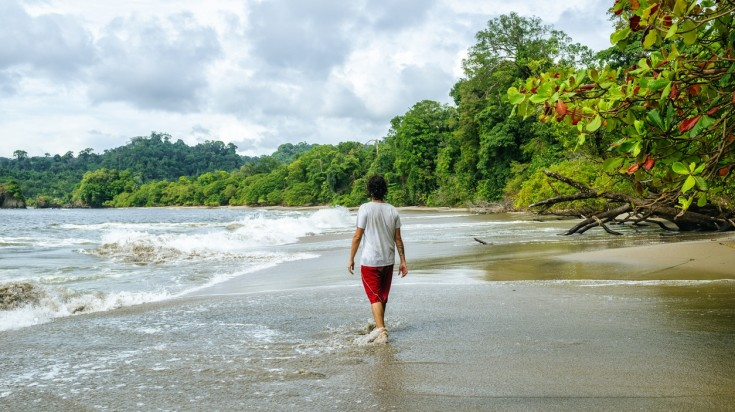 Man walking on the beach in Costa Rica