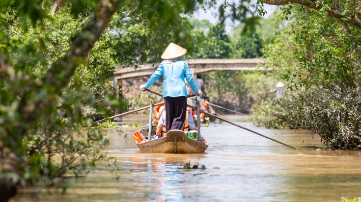 Take a boat ride through Mekong Delta on a 5 day Vietnam itinerary