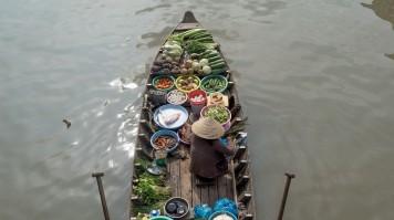 When spending 7 days in Vietnam, visit the floating markets of Mekong Delta