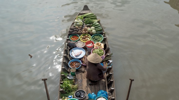 When spending 7 days in Vietnam, visit the floating markets of Mekong Delta