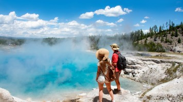 Visitors enjoy the sight of the hot springs in Yellowstone National Park
