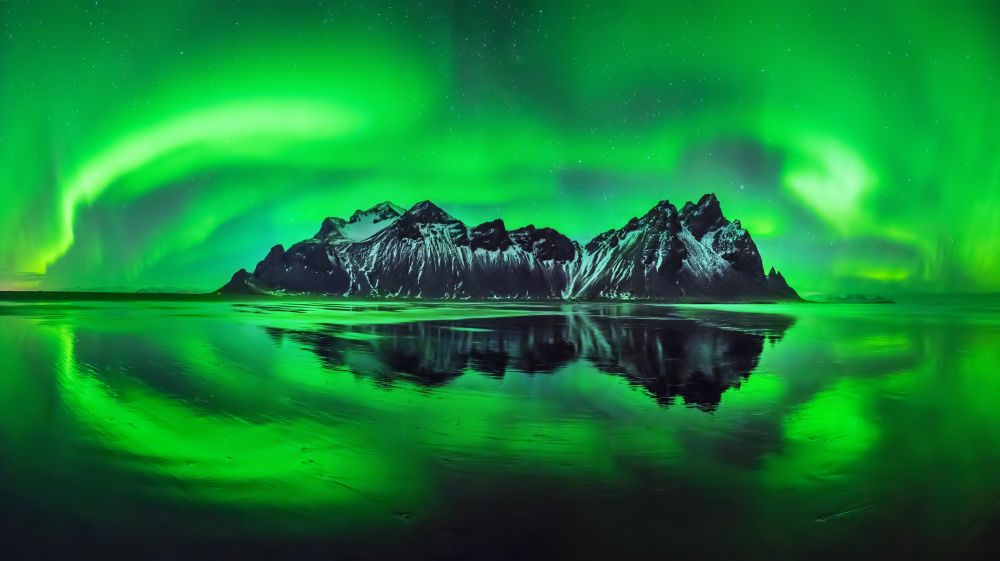 The Scientific Explanation Behind Northern Lights. Aurora Borealis In  Iceland