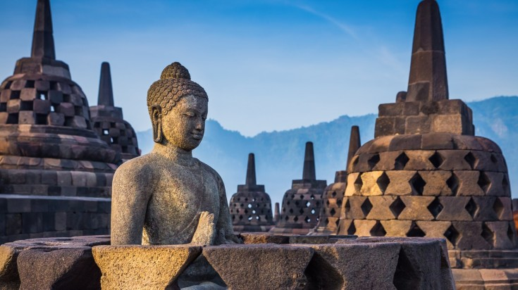 Borobudur, an Indonesian temple is popular for its open work stupas.