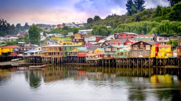 Colorful houses build on wooden struts over a lake