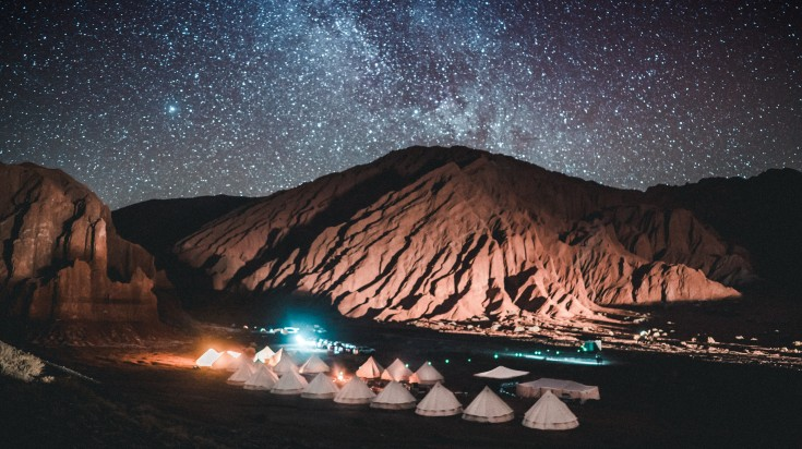 Star-studded night sky against the arid hills of Atacama