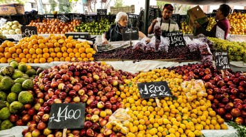 An array of fruits on display in a market in Santiago
