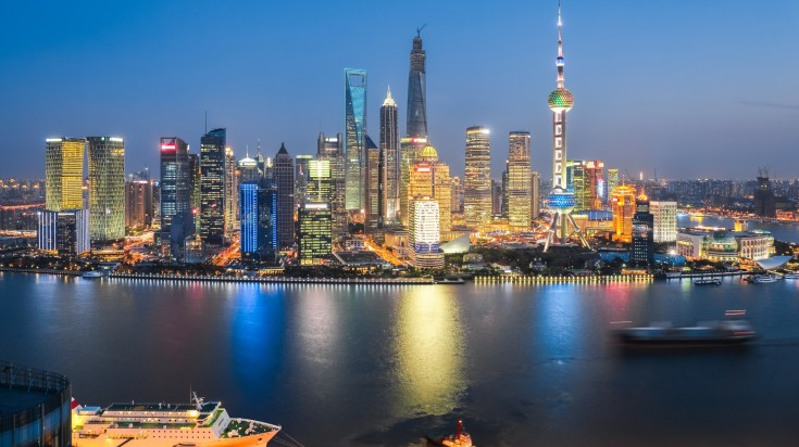 Night view of cruises and the Pudong Skyline in Shanghai