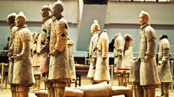 A handful of  cracked and beheaded Terracotta Army statues