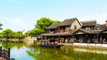 People boating and relaxing at the Covered Corridor, Xitang Water Town