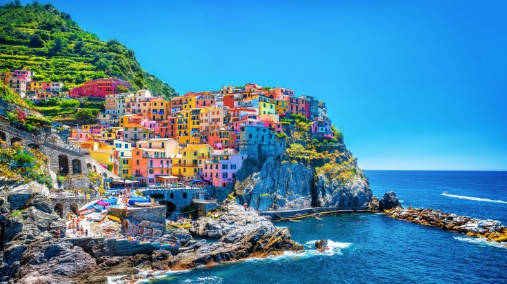 Hiking in Italy via Cinque terre trail—A famously scenic trek.