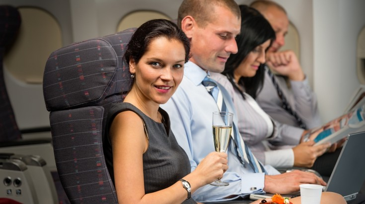 Relaxing on a plane with a glass of wine
