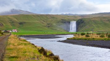 Golden Circle Tour in incomplete without a visit to the Skogafoss waterfall