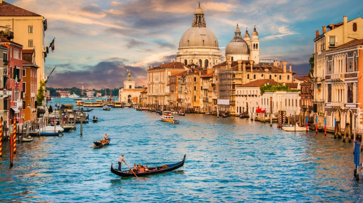 Taking a gondola ride in the Grand Canal of Venice is one of the most popular things to do in Italy.