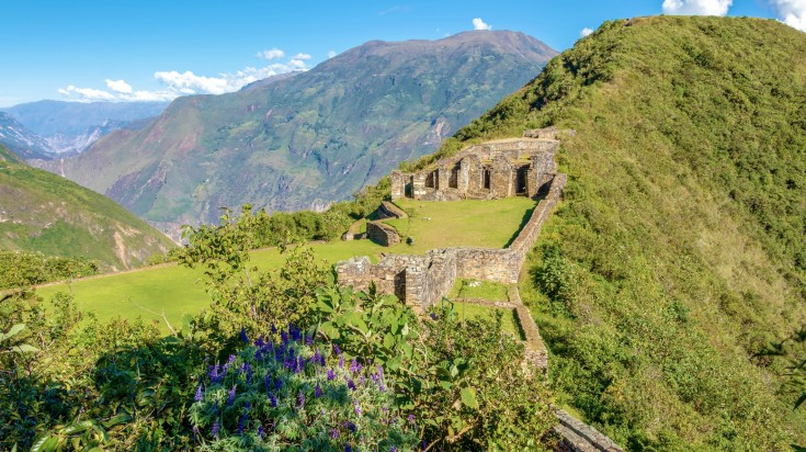 A view of the ruins of the Incan site in Peru atop a hill