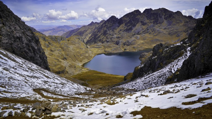 View of the lake and Lares Valley from the top of the mountain pass