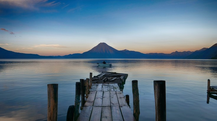 A view  Lake Atitlán in Panajachel, Guatemala with a backdrop of Volcanoes