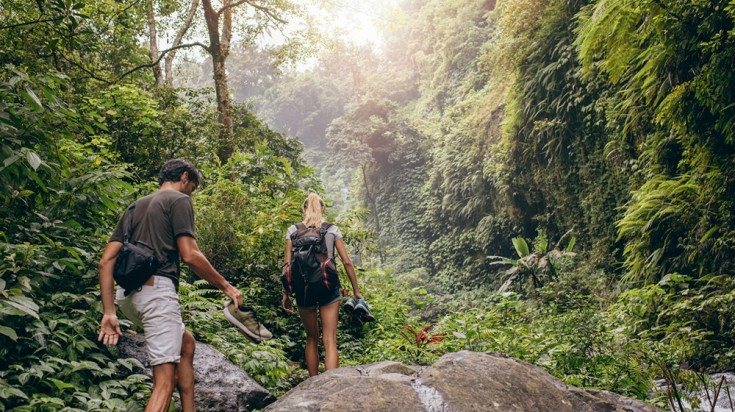 Couple hiking through the jungle in Costa Rica
