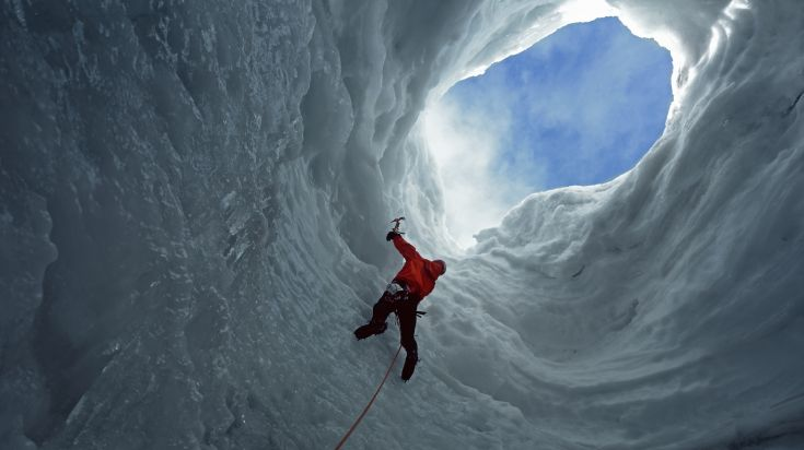 Man climbing Solheimajokull glacier in Iceland