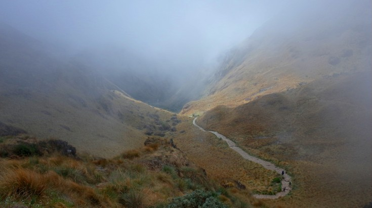 Trekkers walks a misty Inca Trail towards the Dead Woman's Pass