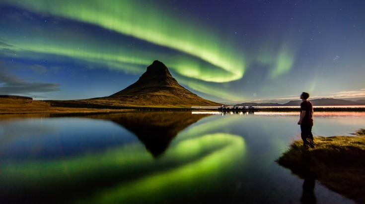 Northern lights looks like the sky is dancing with celestial colors.