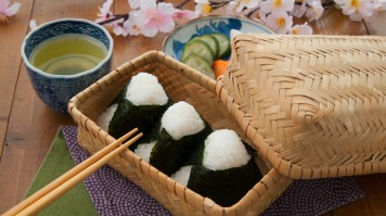 Wrapped in seaweed, Onigiri is a Japanese rice ball in various shapes.