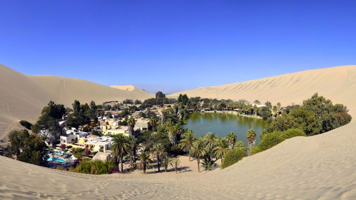 The magical town is called Huacachina that can be found in a barren desert