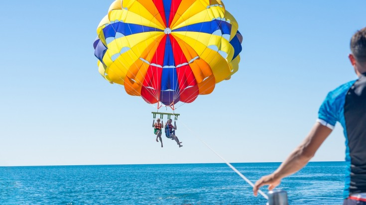 Parasailing in Jaco beach, Costa Rica is a perfect way to enjoy the beach