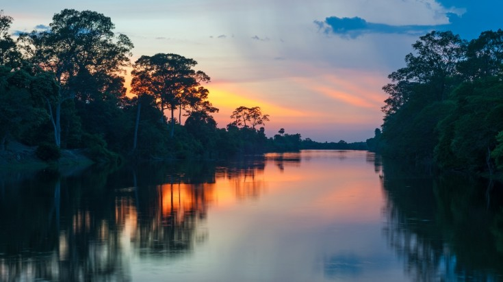 Sunset at a river boat tour in Manu National Park in Peru