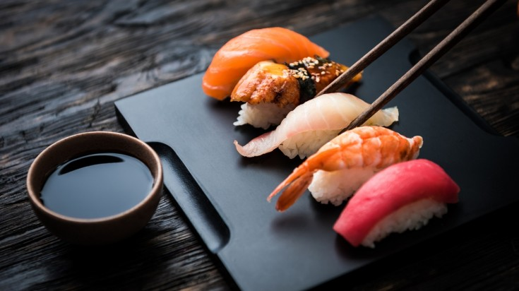 Sashimi consists of raw fish or meat that is sliced into thin pieces.