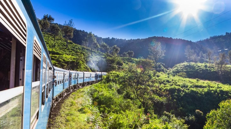 Take train from Ella to Kandy and enjoy the scenic view of green hills