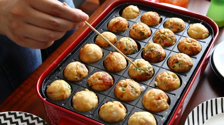 Takoyaki is a round shaped snack in Japan and consists of minced octopus.
