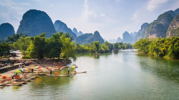 Bamboo rafts waiting for customers on the bank of the Yulong River