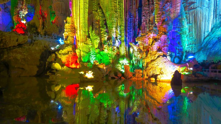 The Reed Flute Cave artificially enhanced by multi-colored lights