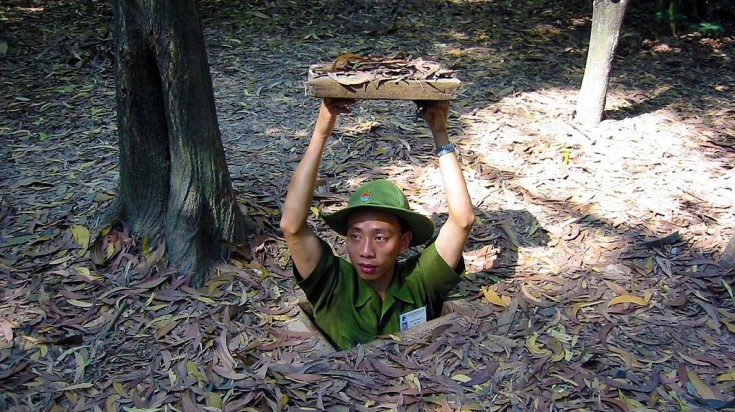 Guide in Ho Chi Minh city coming out of Cu Chi tunnels