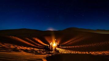 Stay the night in the Sahara desert under glittering stars in Morocco