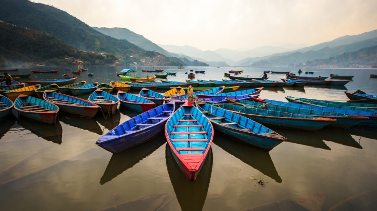 colorful boats on the lake in Pokhara