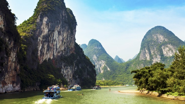 Motorized boats taking tourists around the Li River