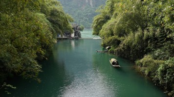 Small boat near the Three Gorges Dam which is the biggest dam in the world