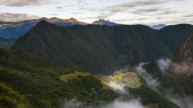 Salkantay Trek in Peru allow you glimpses of Machu Pichhu.
