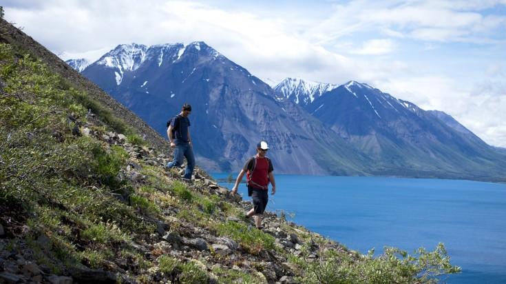 Two hikers walking on the Yukon territory