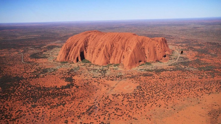 Aerial view of Uluru Rock that shows the size of the massive monolith.