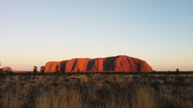 Uluru Rock during sunrise.