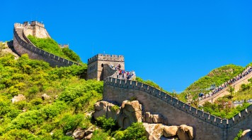 Tourists walking the Great Wall of China on a sunny day