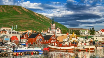 Boats lined up in Husavik for whale watching in Iceland