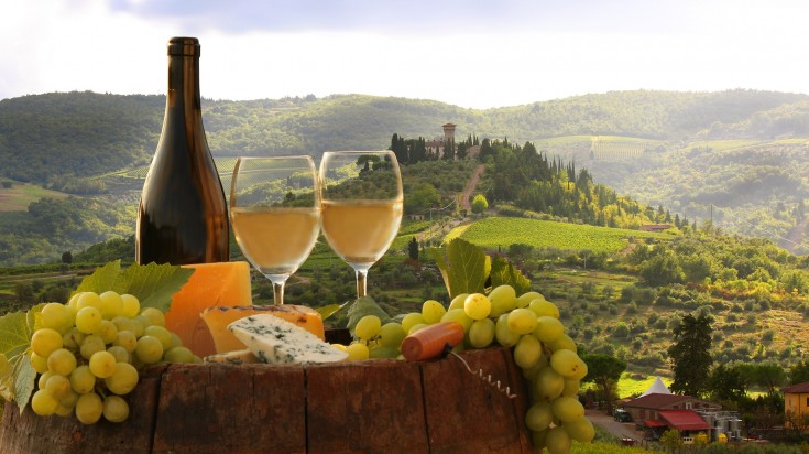 Eating local Italian pasta and drinking red wine under the setting sun of tuscany is one of the top things to do in Italy.