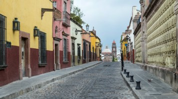 The colorful, cobbled street of San Miguel de Allende in Mexico