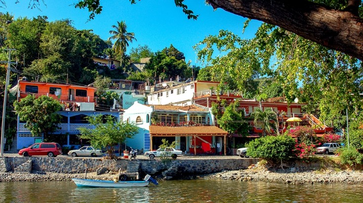 Colorful houses next to a pond in Zihuatanejo in Mexico