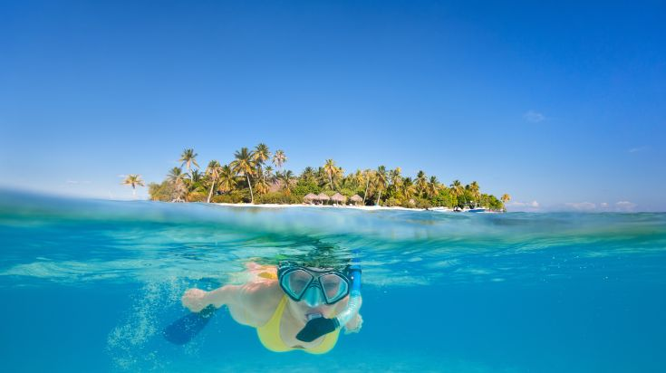 Woman snorkeling in the tropical paradise of Kendwa Beach