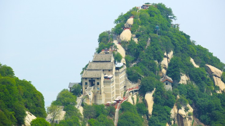 A view of ancient buildings and narrow stairs atop a hill